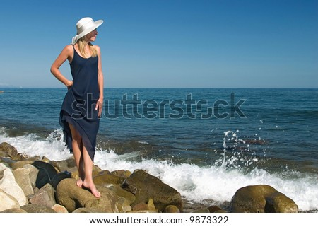 The girl in a dress on stones - stock photo