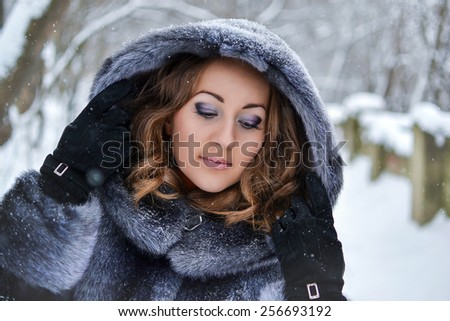 The girl in a fur coat in winter