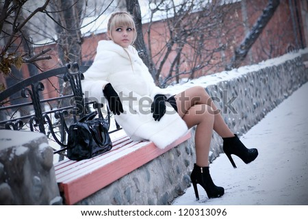 The girl in a fur fur coat - stock photo