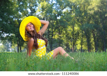The girl in a hat on nature