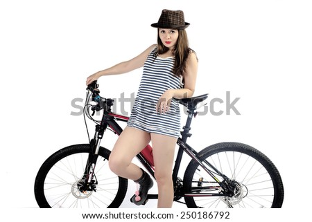 The girl in a hat with a bicycle on a white background close up