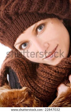 The Girl in a knitted cap smiles