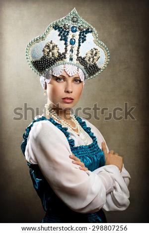 The girl in a kokoshnik - stock photo