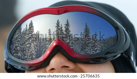 The girl in a mask for snowboarding, close up - stock photo