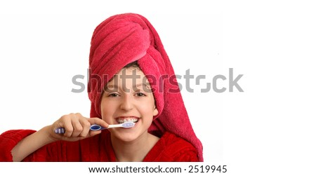 The girl in a red dressing gown cleans a teeth - stock photo