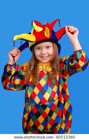 The girl in a suit of the clown on blue - stock photo