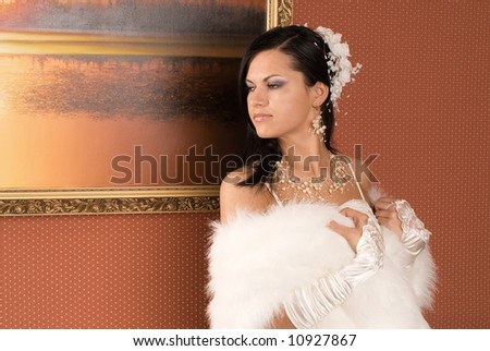 The girl in a wedding dress on beautiful background