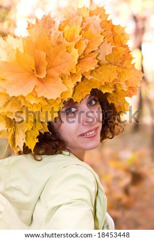 The girl in a wreath from autumn leaves - stock photo