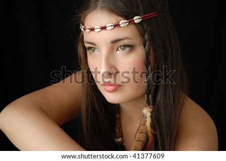 The girl in ethnic American Indian ornaments - stock photo