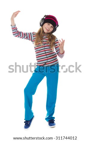 The girl in headphones dancing to the music on a white background.