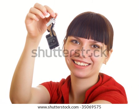 The girl in red clothes holds a sheaf of keys - stock photo