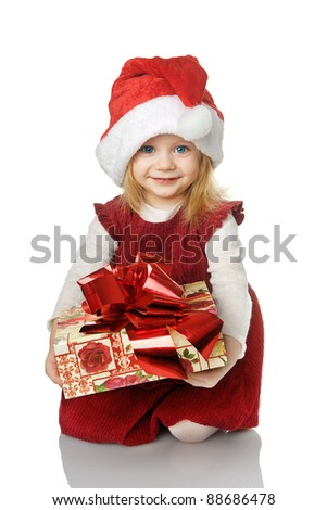 The girl in Santa hat with a gift. isolated on the white - stock photo