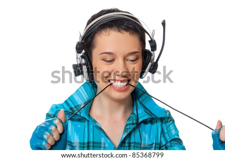 The girl in the blue shirt listening to music on headphones fun posing isolated on white background - stock photo
