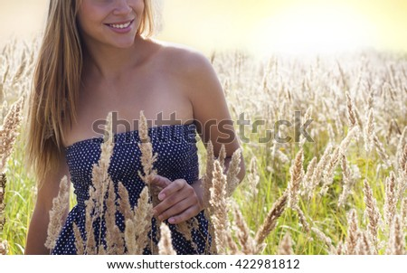 The girl in the field. - stock photo