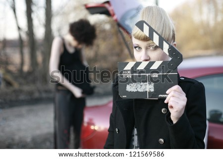 the girl in the film production with clapperboard - stock photo