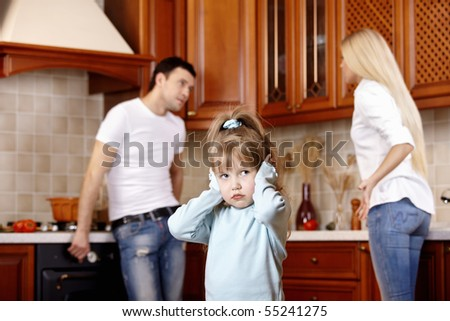 The girl in the foreground at quarrel of parents - stock photo
