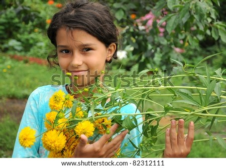 The girl in the garden with yellow flowers