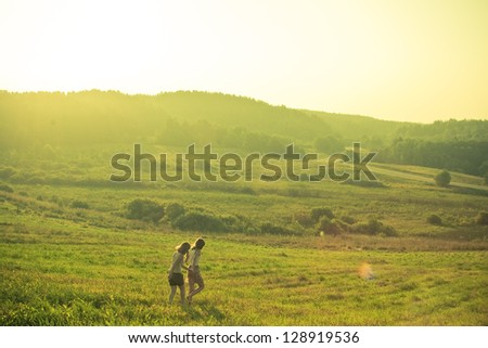 the girl in the meadow - stock photo