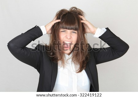 The girl in the office clothes. The black jacket and skirt, white blouse. She grabbed her head and shouts. - stock photo