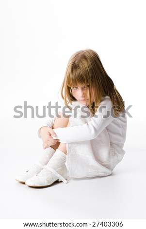 The girl in white clothes on a white background. - stock photo