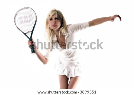 the girl is hitting the ball - stock photo