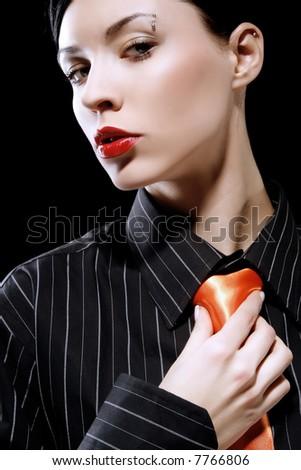 the girl is holding her orange tie - stock photo