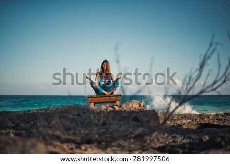 the girl is meditating by the sea