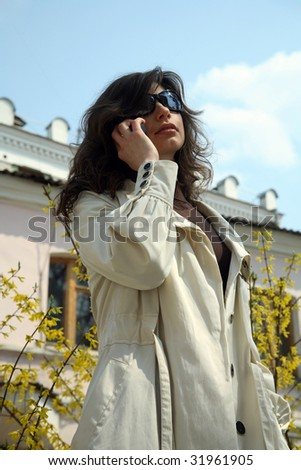 The girl is talking on the phone - stock photo
