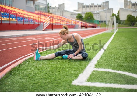 the girl is trained at the beautiful stadium