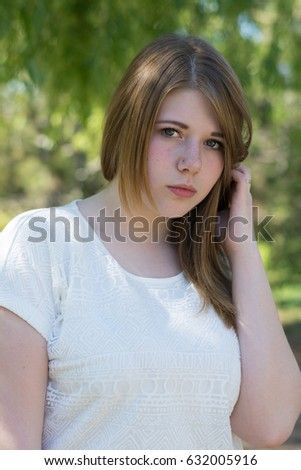 The girl is upset with the interlocutor, the close person. Portrait of a blonde outdoors