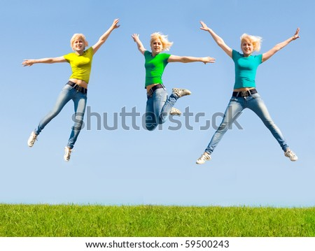 The girl jumped over the grass - stock photo