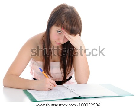 The girl, looking frowningly, signs documents. On a white background.
