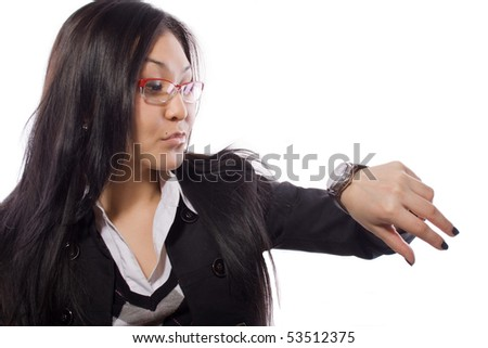 The girl looks at time - stock photo