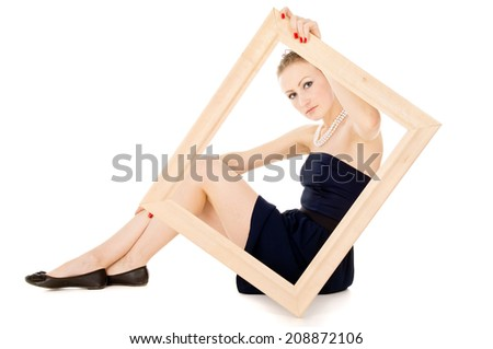 the girl looks in a frame isolated on white background - stock photo