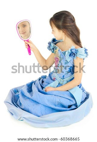 The girl looks in a mirror