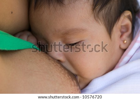 The girl 2 months, a parent breast - stock photo