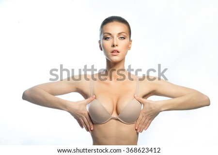 The girl of the European appearance, with a beautiful, large breasts, happy after plastic surgery. - stock photo