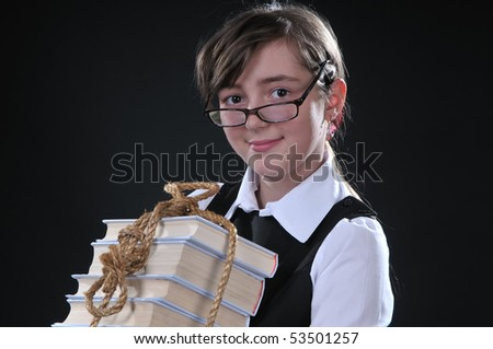 the girl of twelve years gets on the hip the copula of books - stock photo