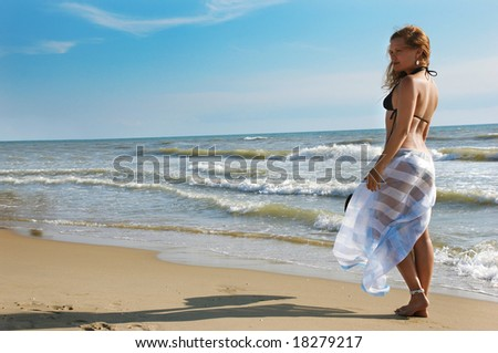 The girl on a beach - stock photo