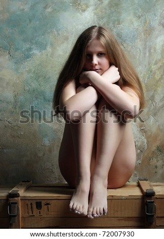 The girl on a chest - stock photo