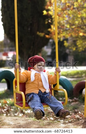 The girl on a swing - stock photo