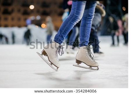 the girl on the figured skates on a opened skating rink - stock photo