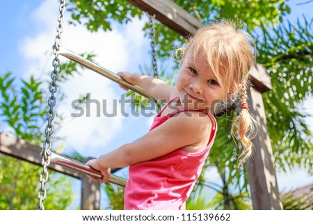 the girl on the playground - stock photo