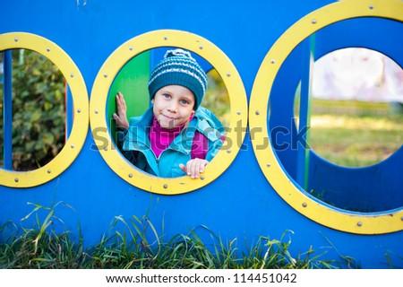 the girl on the playground, autumn - stock photo