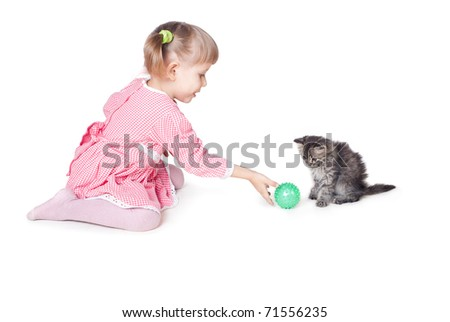 The girl plays with a kitten, an interior, white background - stock photo