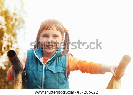 The girl pulled on the bars. - stock photo