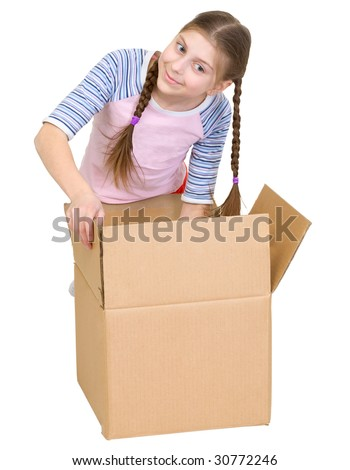 The girl rummages in a cardboard box