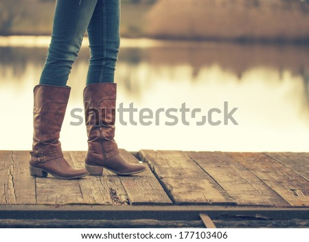 The girl's legs and retro boots - stock photo