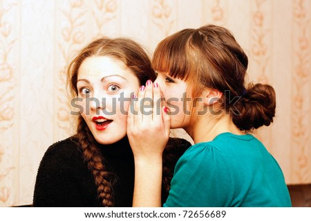 The girl shares the secrets of her friend - stock photo