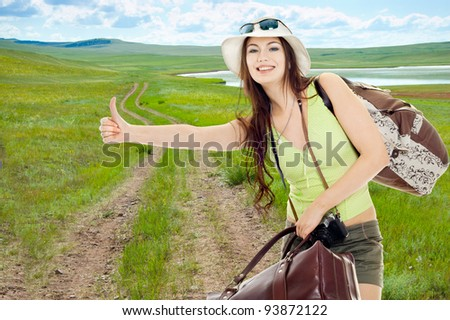 The girl shows catches a passing car - stock photo